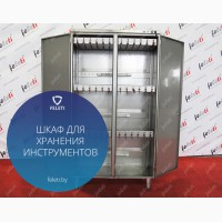 Cabinet for storage and sterilization of tools